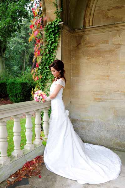 6cae36c893e0 Silk ivory duchess satin and French lace. Binding of ivory satin and swarovski  crystal on the veil. Silk and lace wedding dress